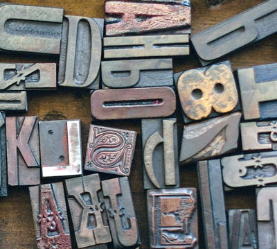 Wooden type letters jumbled as a metaphor for dyslexia